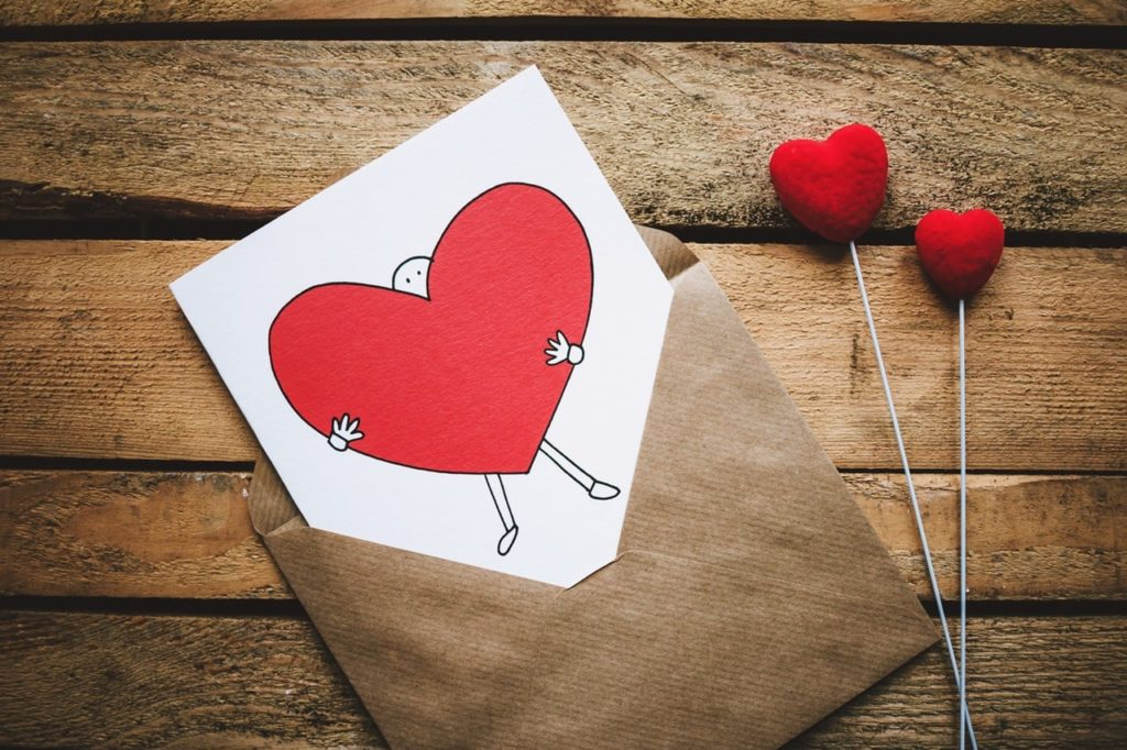 •	https://www.pexels.com/photo/white-black-and-red-person-carrying-heart-illustration-in-brown-envelope-867462/